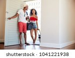 couple arriving at summer... | Shutterstock . vector #1041221938