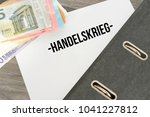 euro bills  a folder and the... | Shutterstock . vector #1041227812