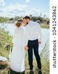 beautiful wedding couple  bride ... | Shutterstock . vector #1041243862