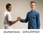 teenager friends shaking hands | Shutterstock . vector #1041249565
