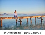 barefoot woman sitting on a... | Shutterstock . vector #1041250936