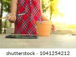 asian little girl painting... | Shutterstock . vector #1041254212