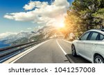 white car rushing along a high... | Shutterstock . vector #1041257008