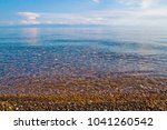clear turquoise water  stony... | Shutterstock . vector #1041260542