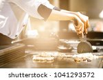 hand of man take cooking of... | Shutterstock . vector #1041293572