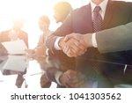 handshake business partners at... | Shutterstock . vector #1041303562