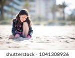 little girl on vacation posing... | Shutterstock . vector #1041308926