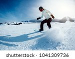 one snowboarder snowboarding in ... | Shutterstock . vector #1041309736