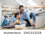 young couple watching movie on... | Shutterstock . vector #1041313228