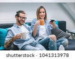 young couple sitting on the... | Shutterstock . vector #1041313978