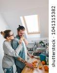 young couple making breakfast... | Shutterstock . vector #1041315382