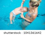 adorable baby girl enjoying... | Shutterstock . vector #1041361642