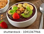 frozen acai berry bowl with... | Shutterstock . vector #1041367966