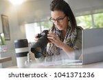 young woman photographer...   Shutterstock . vector #1041371236