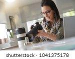 young woman photographer... | Shutterstock . vector #1041375178