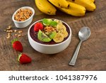 acai berry bowl with sliced... | Shutterstock . vector #1041387976