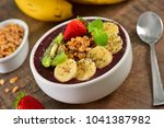 acai berry bowl with sliced... | Shutterstock . vector #1041387982