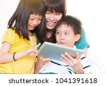 asian mother and kids using... | Shutterstock . vector #1041391618