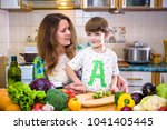 the young cook mother standing... | Shutterstock . vector #1041405445