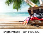 suitcase of travel time and... | Shutterstock . vector #1041409522