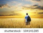 man in yellow wheat meadow on... | Shutterstock . vector #104141285