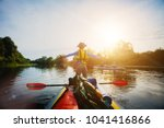 happy boy kayaking on the river....   Shutterstock . vector #1041416866