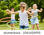 children playing with hoops in...   Shutterstock . vector #1041420955
