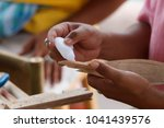 traditional craftsman making... | Shutterstock . vector #1041439576