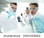 closeup. scientist and... | Shutterstock . vector #1041443002