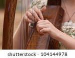 Young Woman Playing A Harp
