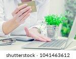 asian business woman holding... | Shutterstock . vector #1041463612