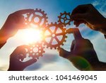 silhouettes four hands collect... | Shutterstock . vector #1041469045