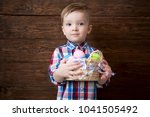 happy baby boy with a basket of ... | Shutterstock . vector #1041505492