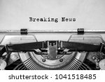 breaking news text typed on an... | Shutterstock . vector #1041518485