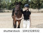 rider and horse go to the... | Shutterstock . vector #1041528532
