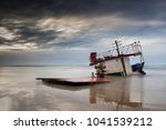 the broken ship along with the... | Shutterstock . vector #1041539212