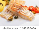 cod fillets with olives and... | Shutterstock . vector #1041556666