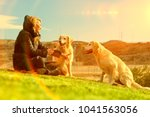 woman and dogs playing in the... | Shutterstock . vector #1041563056