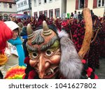 Small photo of Weil der Stadt, Germany - February 11, 2018: Traditional carnival in South Germany - Swabian-Alemannic Fastnacht. A male witch wearing a wooden mask is approaching visitors of the carnival procession.