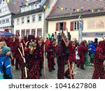 Small photo of Weil der Stadt, Germany - February 11, 2018: Traditional carnival in South Germany - Swabian-Alemannic Fastnacht. A local group is joining the carnival procession wearing traditional costumes and