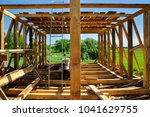 Building new wooden house, under construction work - stock photo