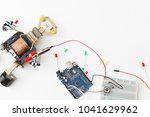 a metal robot and an electronic ... | Shutterstock . vector #1041629962