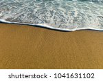 sea waves in the sand | Shutterstock . vector #1041631102