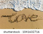 sea waves in the sand with love ... | Shutterstock . vector #1041632716