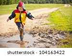 Boy Splashing In Puddle  Havin...