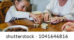 little girl playing dominoes... | Shutterstock . vector #1041646816