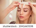 changing the shape of the brows.... | Shutterstock . vector #1041665338