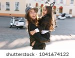 stylish young mom in retro felt ... | Shutterstock . vector #1041674122