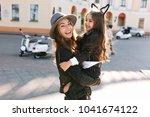 stylish young mom in retro felt ... | Shutterstock . vector #1041674122