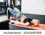woman working out in fitness  ... | Shutterstock . vector #1041689398